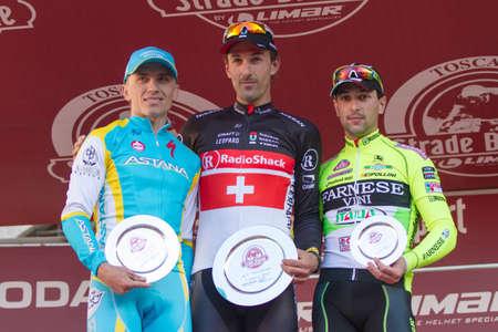 SIENA, ITALY - MARCH 03: Fabian Cancellara, Maxim Iglinskiy and Oscar Gatto on the podium of Strade Bianche 2012, on March 03, 2012 in Siena, Italy Stock Photo - 12513400