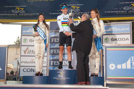 INDICATORE, AREZZO, ITALY - MARCH 08: Mark Cavendish on the podium after winning the 2nd stage of 2012 Tirreno-Adriatico on March 08, 2012 in Indicatore, Arezzo, Italy
