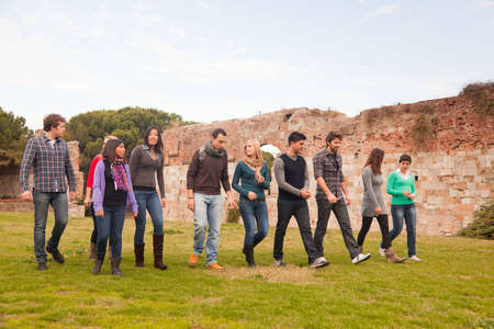 Multicultural Group of People Walking Together Stock Photo - 12958675