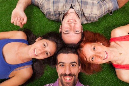 lying on grass: Young People Lying on the Ground