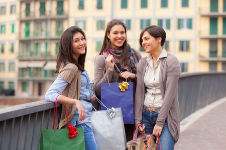 Three Beautiful Young Women with Shopping Bags Stock Photo - 12931724