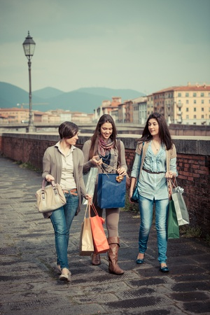 Beautiful Young Women Waliking in the City with Shopping Bags Stock Photo - 12931733