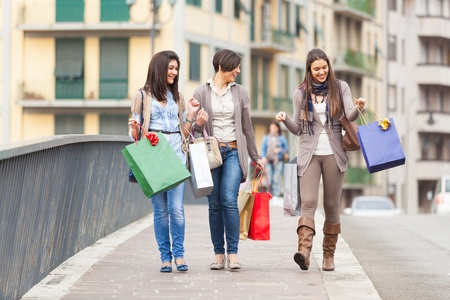 Three Beautiful Young Women with Shopping Bags photo