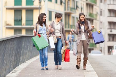 Three Beautiful Young Women with Shopping Bags photo