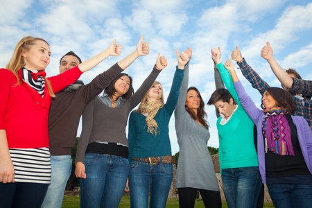 hands raised: College Students with Thumbs Up