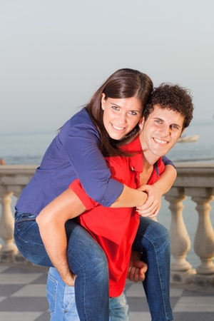 Smiling Young Couple Piggybacking photo