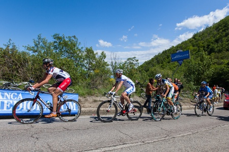 POGGIO ALLA CROCE, FIRENZE, ITALY - MAY 16: Five cyclists on escape, on the climb to gpm,  during the 11th stage of 2012 Giro d'Italia on May 16, 2012 in Poggio alla Croce, Firenze, Italy Stock Photo - 13685699