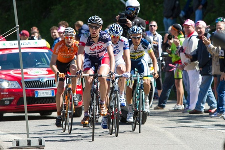 POGGIO ALLA CROCE, FIRENZE, ITALY - MAY 16: Five cyclists on escape, on the climb to gpm,  during the 11th stage of 2012 Giro d'Italia on May 16, 2012 in Poggio alla Croce, Firenze, Italy Stock Photo - 13685678