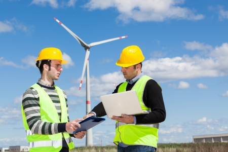 Two Engineers in a Wind Turbine Power Station Stock Photo - 13705865
