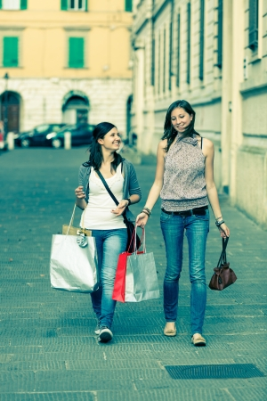 Couple of Women with Shopping Bags photo