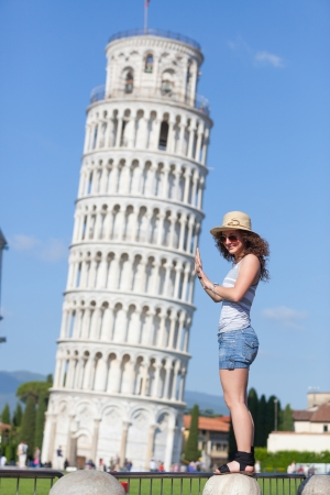 Young Girl with Leaning Tower of Pisa photo