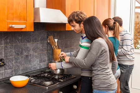 Happy Multiracial Couple in the Kitchen Stock Photo - 14023457