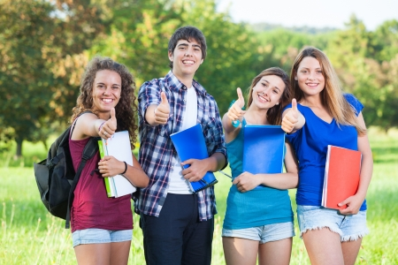 Teenage Students with Thumbs up Stock Photo - 14188458