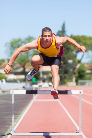 Male Track and Field Athlete during Obstacle Race photo
