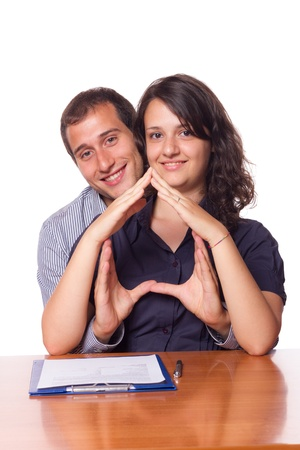 Happy Young Couple Buying an House photo