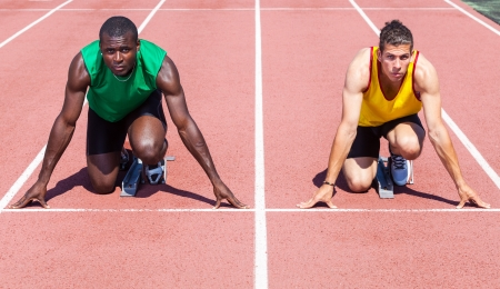 Two Track and Field Athletes before the Race Start Stock Photo - 14613773
