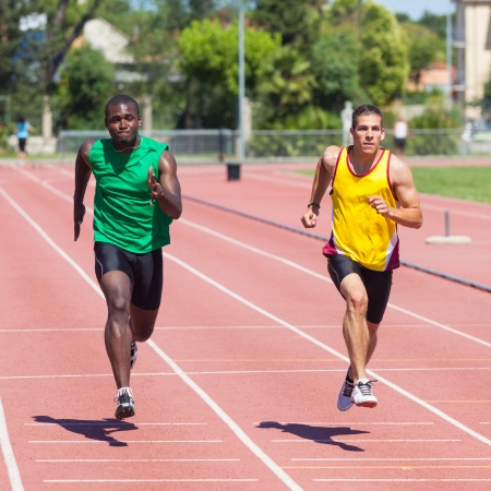 Two Track and Field Athletes Running Stock Photo - 14613694