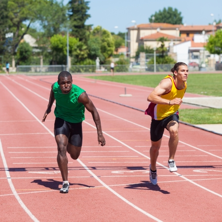 Two Track and Field Athletes Running Stock Photo - 14613673