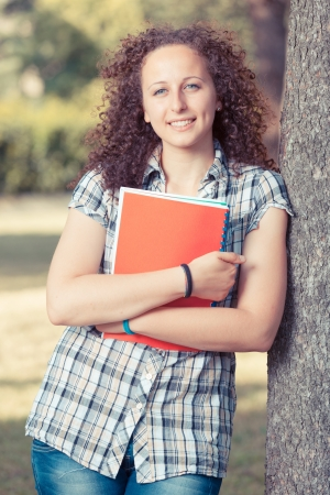 Young Beautiful Female Student at Park photo
