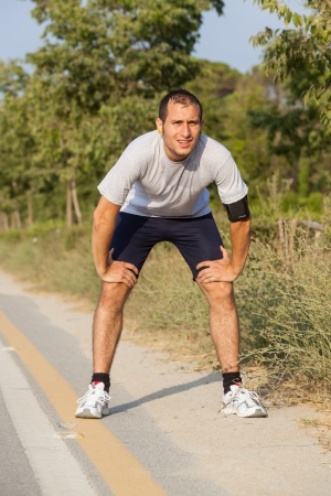 Tired Young Man After Jogging Stock Photo - 14614044
