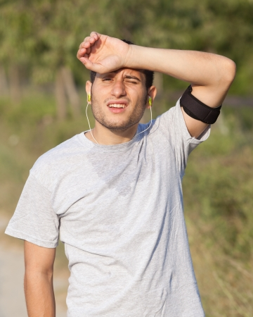 tired man: Tired Young Man After Jogging Stock Photo