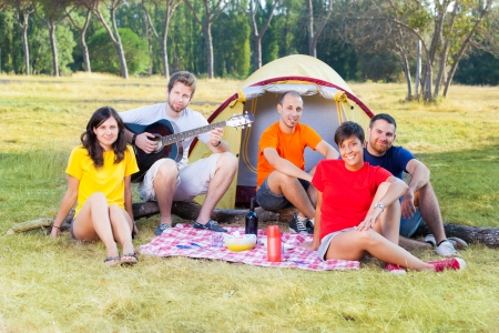 Group of People Camping and Singing photo