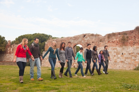 Multicultural Group of People Walking Together photo