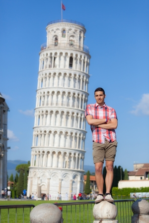 leaning tower of pisa: Young Boy Posing with Leaning Tower in Pisa