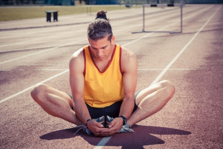 Track and Field Athlete Stretching photo