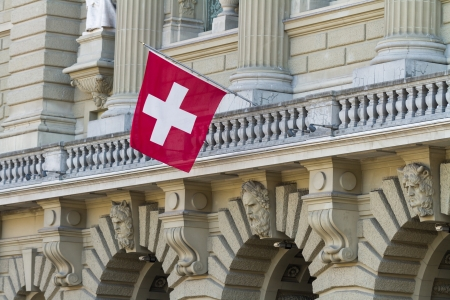 governmental: Bundeshaus Facade with Swiss Flag in Bern, Switzerland