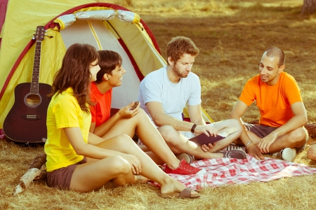 camp: Group of People Camping and Telling Stories Stock Photo