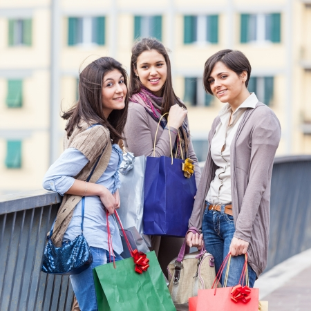 casual dress: Three Beautiful Young Women with Shopping Bags