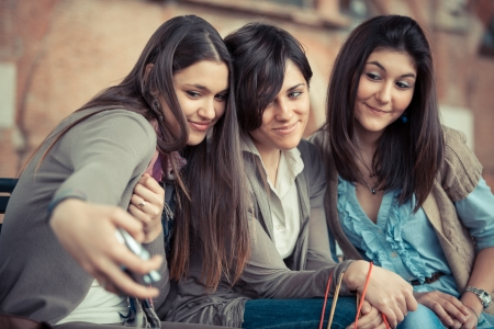 Three Beautiful Women taking Self Portraits photo