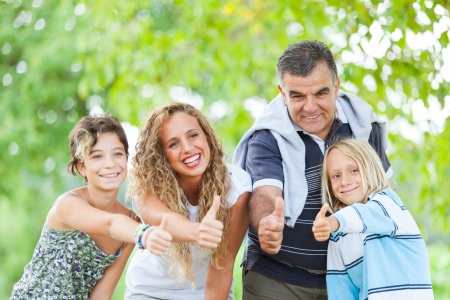 Happy Family Outdoor with Thumbs Up Stock Photo - 15019124