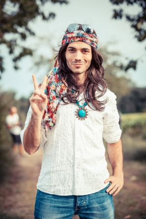 man with long hair: Hippie Portrait showing Peace Sign