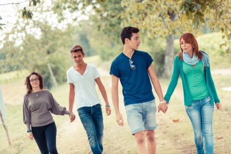 Group of Teenagers Walking Holding Hands photo