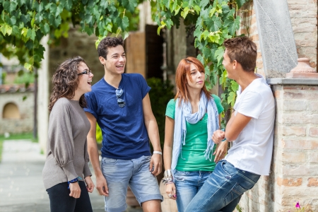 teenagers laughing: Group of Teenagers Outside Stock Photo