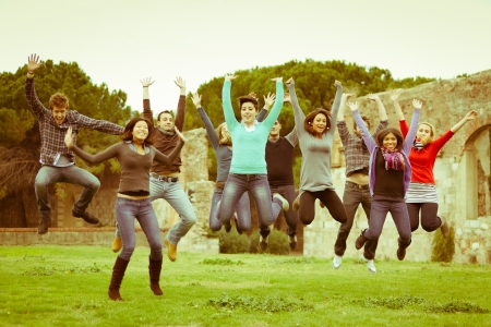 Multicultural College Students Jumping photo