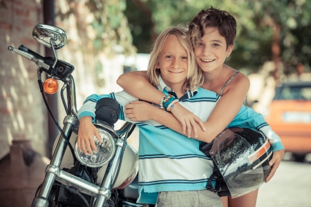 Couple of Children with Motorbike Stock Photo - 15096206