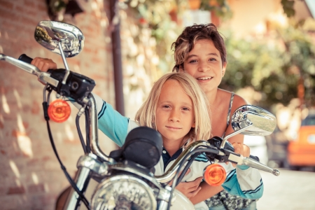 Couple of Children with Motorbike Stock Photo - 15096076