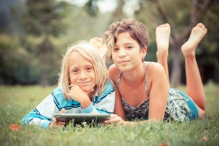 Couple of Children with Tablet PC photo