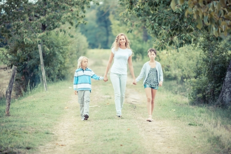 Beautiful Young Woman with Two Children Outside photo