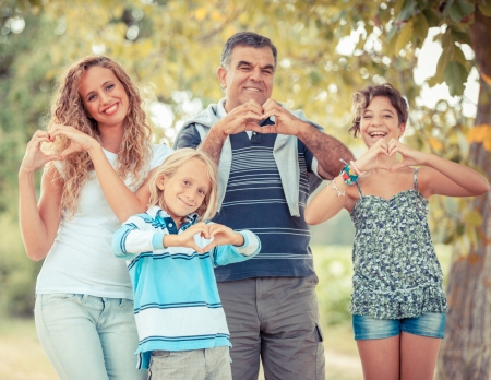 Happy Family with Heart Shaped Hands photo