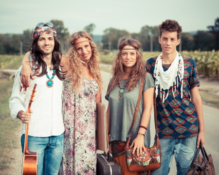 street party: Hippie Group Walking on a Countryside Road