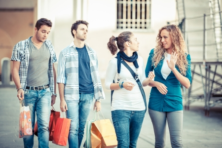 Happy Girls With Bored Boys on Shopping photo
