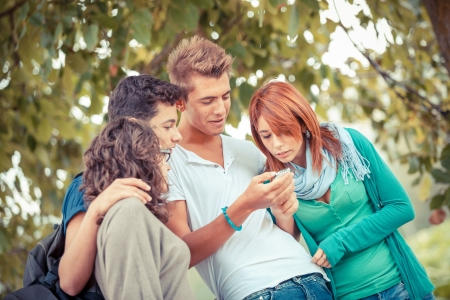 chat group: Group of Teenage Friends with Mobile Phone