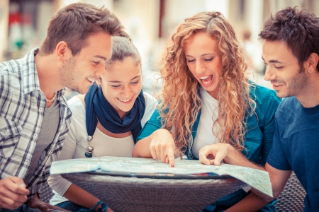 italy map: Group of Tourists Looking at Map