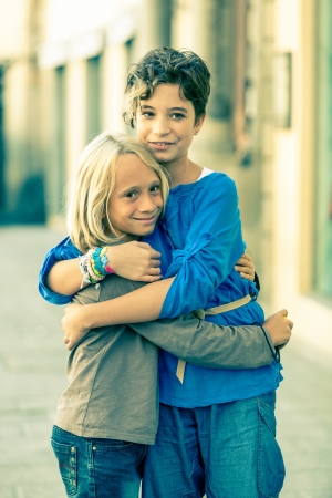 Little Boy and Girl Embraced