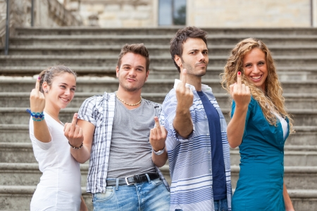 Group of Friends showing Obscene Gesture photo