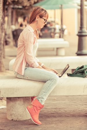 student with laptop: Beautiful Young Woman with Computer Outside
